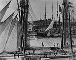 Photograph of sailing vessels awaiting lockage in old Welland Ship Canal, circa 1890-1900