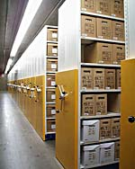 Photograph of the mobile shelving units used to store boxed textual records.
