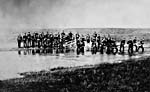 Photo of the men of the Halifax Provisional Battalion crossing a stream near Swift Current, Saskatchewan, 1885