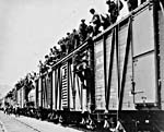 Photo of strikers from unemployment relief camps en route to eastern Canada during the ON TO OTTAWA TREK, June 1935
