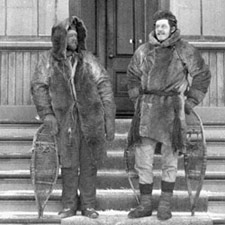 Photograph of Joseph Tyrell and Monroe Ferguson posing in winter field gear on the steps of a building, 1894
