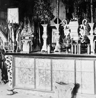 Photograph of ornate altar with many small objects on top