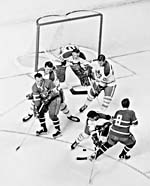 Photograph of the Montreal Canadien hockey team in action against the Toronto Maple Leafs, Montréal, Quebec, circa 1965