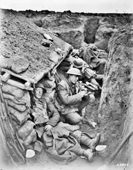 Photograph of men resting in a First World War trench.