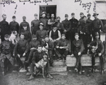 "Photograph of NWMP in front of old barrack room Division ""A,"" Maple Creek, Saskatchewan, 1892"