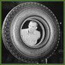 Workman John Seliger makes the final inspection of a new synthetic rubber tire at the Dominion Rubber plant