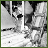 Female operator Clemance Gagnon watches a machine carding asbestos fibre for spinning and processing at the Johns-Manville factory
