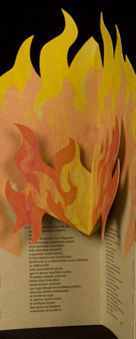 The panel of the accordion book has yellow and orange flames that pop out of the page, beneath which is black print on light brown paper.