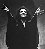 Photograph of Shirley Douglas with raised arms outstretched