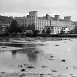 Photograph of a cotton mill below Montmorency Falls, Quebec, early 1900s