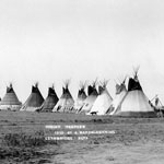 Photograph of thirteen teepees, Lethbridge, Alberta, 1910
