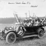 Photograph, entitled CANADIAN PATRIOTIC INDIAN CHIEFS, of six Aboriginal men dressed in traditional clothing, riding in a car, Saskatchewan, circa 1915