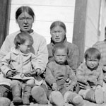 Photograph showing eight Inuit women and children, Lake Harbour, Northwest Territories, 1931