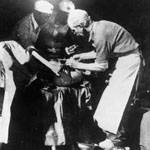 Photograph of Norman Bethune, another doctor and two nurses performing surgery, China, 1939