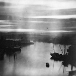Photograph of a lakeside scene at dawn or dusk showing silhouettes of boats and buildings, possibly in Victoria, British Columbia, circa 1927