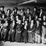 Photograph of a group of about 25 women upon their arrival in Canada to work as domestic help, Québec, Quebec, circa 1911