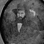 Photograph, in an oval frame, of an unidentified man wearing a hat, circa 1850-1855