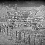 Photograph of Allan's Mill, with a road in front on which there are people and buggies, Guelph, Ontario, circa 1855