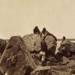Photograph of men climbing rocks, Newfoundland, circa 1857-1859