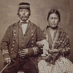 Photograph of Captain Jack, chief of the Rupert Indians, in military uniform and his wife in European clothing, British Columbia, circa 1868-1878