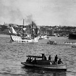 Photograph of a sailing ship, steamships, and several canoes in the Saint Lawrence near Québec City, 1908