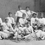 Photograph of a thirteen-member Mohawk lacrosse team from Kahná:wake, 1869