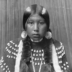 Photograph of an Aboriginal woman in traditional clothing and jewelry, date unknown