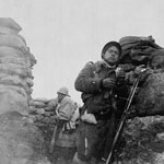 Photograph of two soldiers in a sandbagged trench, Spain, circa 1937-1937