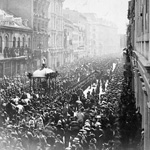 Photograph of a street lined with people on both sides while the funeral procession of Thomas D'Arcy McGee goes by, Montréal, 1868