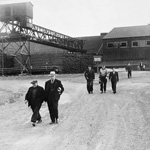 Photograph showing several steel workers leaving the plant after their last shift before going on strike, Sydney, Nova Scotia, 1946